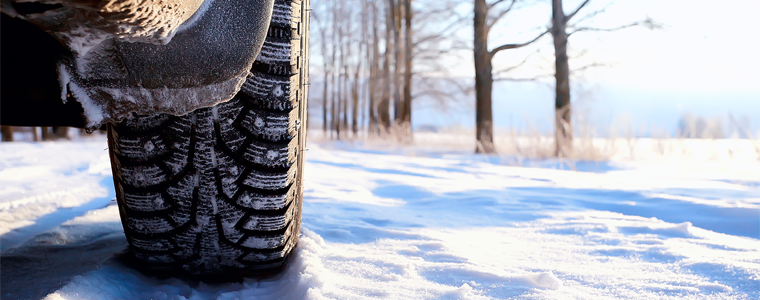 car tire and tracks in snow